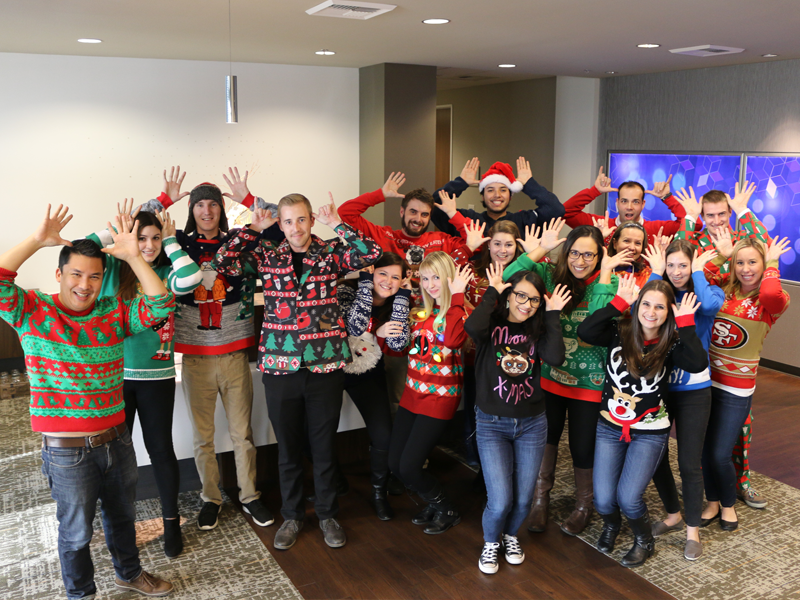 IA Staff in ugly holiday sweaters