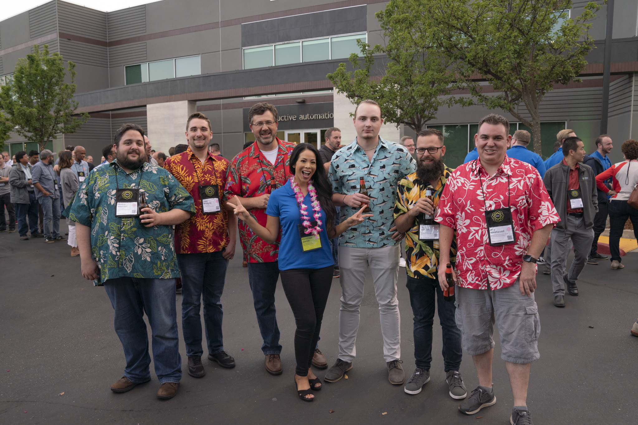 Six Roeslein employees wearing different Hawaiian shirts,  with IA Account Executive Vannessa Garcia standing in front holding up two peace signs